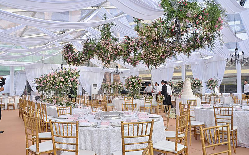 faliq and chrysies wedding venue white hanging florals
